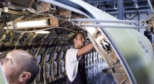 Photo of people repairing airplane cabin